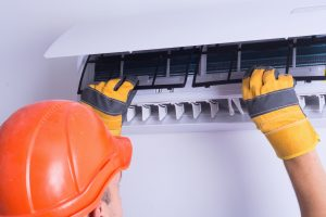 checking air conditioner under home warranty